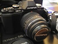 Olympus OMD EM5 camera with 14-42 lens. MINT
