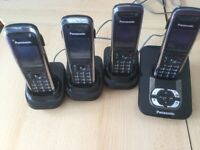Panasonic cordless phone set with 4 handsets.