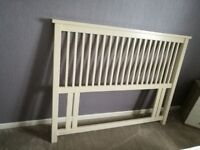 Cream wooden headboard for a double bed