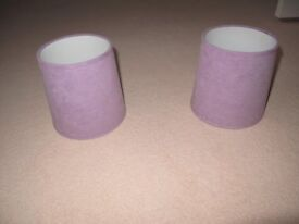 Two small mauve coloured lampshades