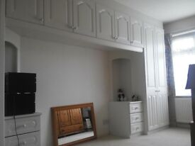 Fitted wardrobes, drawers and dressing table/ work desk with cupboards over