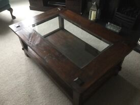 Cdark wood coffee table with under shelf and glass insert top 120x80cms