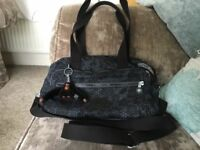 As new Kipling hand bag With 3 large compartments.with Davina monkey