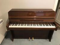 Zender compact upright piano