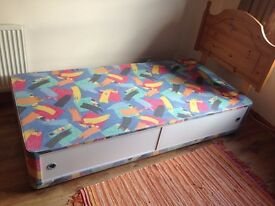 Single divan bed with draws and pine headboard. In good condition