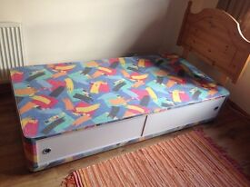 Single divan bed and mattress.Drawers and pine headboard. In good condition