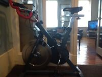exercise spin bike unwanted gift in very good condition.