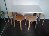 Four wooden chairs and a table from IKEA