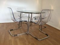 Ikea - Glass table with 4 matching chairs. Never used, excellent condition.