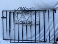 Lovely pair of black metal garden gates