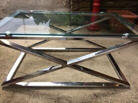 Glass coffee table with steel frame