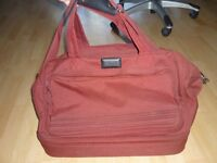 NEW AND UNUSED. OVERNIGHT / WEEKEND TRAVEL BAG WITH UNDERSIDE COMPARTMENT.
