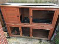 Two large rabbit hutches outdoor and indoor