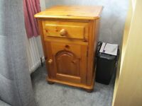 Solid Pine Bedside Cabinet. Drawer at top with door at bottom. Approx H 28in W 19 in D 16 in.