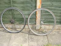"""two road bike wheels 27"""" with 5 speed cassette on the back wheel"""