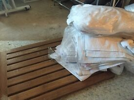 Bath mats - one wooden & lots of white ones