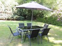 Black smoke glass patio table