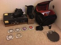 Nikon D3100 DSLR camera with 18-55 VR lens kit and extra 55-200 lens (+ extras)