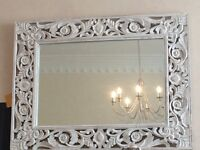 This is a fantastic mirror with an intricate carved wooden frame. Looks fantastic on any wall.