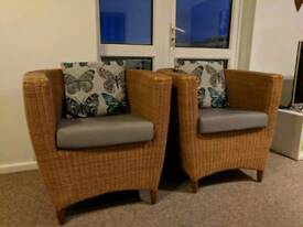 Two wicker chairs with cushion