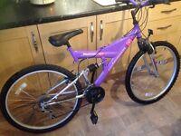 "Ladies universal Odessa ATB X2 mountain bike. Purple 18"" frame, 26""wheels , full suspension."