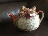 Knitted owl tea cosy