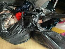 2 black bags of girls clothes