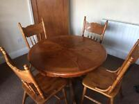 Hardwood round dining table and four chairs
