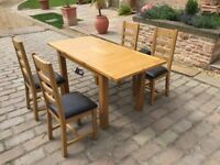 BRAND NEW SOLID OAK EXTENDING DINING TABLE AND 4 CHAIRS