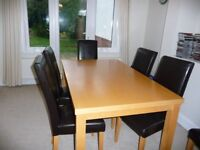 Dining table and 6 dark brown chairs