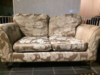2 seater floral fabric sofa with spare set of covers for the cushions