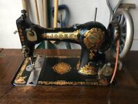 Jones sewing machine and treadle