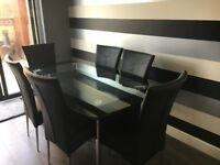 Glass dining table with 6 leather chairs and 2 matching side tables