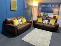 Orange tan brown leather suite 3 seater sofas x 2