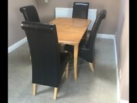 Solid wood table and 4 dark brown faux leather matching chairs ex condition