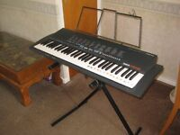 Yamaha PSR-18 stereo keyboard(with stand and music notes stand and also dust cover)