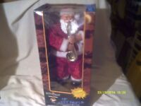 SANTA PLAYS the SAXOPHONE STILL In HIS BOX , ONLY CAME OUT FOR HIS PICTURE SO NEW COND