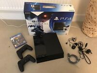 PlayStation 4. Great condition. 2 controllers. Includes a game
