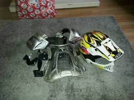 Kids motorcycle helmet and armour.