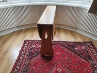 Ercol blond gate leg drop leaf dining table