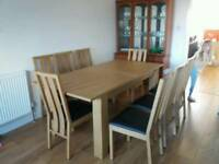 Solid exrended table with 8 chairs