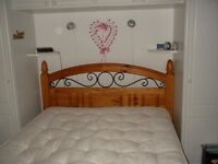 DOUBLE WOODEN BED WITH ORNATE WROUGHT IRON DETAIL IN HEADBOARD/FOOTBOARD + STODDART MATTRESS