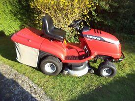 "Tractor sit on lawn mower. Honda model HF2417 HME, 40""(102cm) cutter width, 17HP vee twin engine."