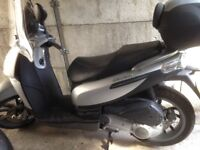 Piaggio Carnaby 124cc Scooter,good condition,one owner,back box,windscreen, helmet and gloves