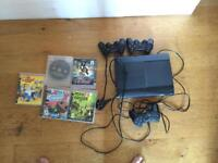 PS3 with 3 controllers and 5 games