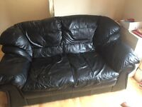 Black 2 seater leather settee