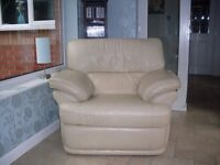 two cream leather recliner chairs