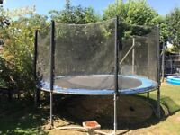 12ft Trampoline. 14ft overall. Used condition. Safety sides intact apart from one large rip.