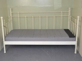 Cream coloured metal day bed