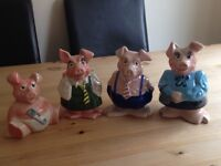 Immaculate set of 4 Natwest pigs with original stoppers.